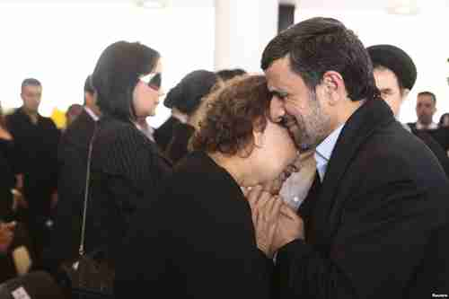 Ahmadinejad hugs Chávez's mother, Elena Frias, during funeral services on Friday (Reuters)