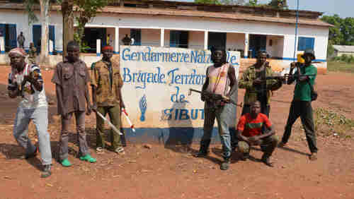 Seleka rebels pose for photo op in front of suburban gendarmerie (police station) in January (Getty)