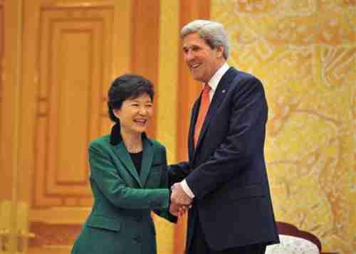South Korean President Park Geun-Hye shakes hands with John Kerry on Friday (Reuters)