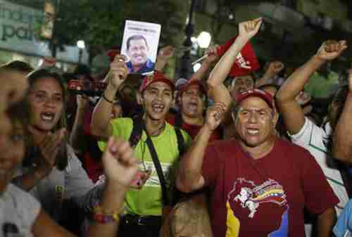 Maduro supporters shout slogans during a Tuesday protest in Caracas (Reuters)