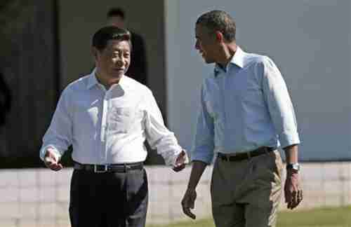 Xi and Obama having informal shirtsleeve discussions (Reuters)