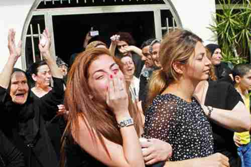 Funeral for Hashem Salman, 28, who was who was shot and killed at a rally outside Beirut's Iranian Embassy Sunday while protesting Hezbollah's involvement in the Syrian conflict. (Daily Star)