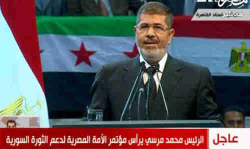 Mohamed Morsi speaking in Cairo on Saturday (Al-Ahram)