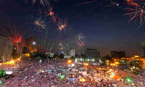 Fireworks burst over anti-Morsi protesters in Cairo's Tahrir Square (AP)