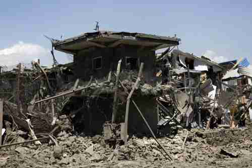 Ruins of Nato supply building in Kabul on Tuesday (AP)
