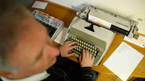 Presumably a Russian agent typing on an electric typewriter (RT)