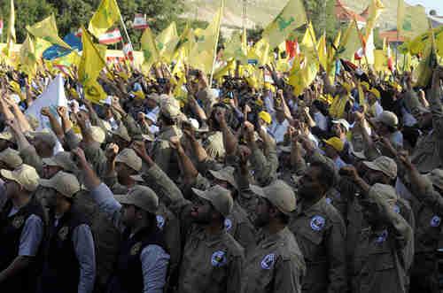 Hezbollah army saluting (EPA)