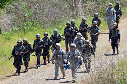 Philippine (left) and U.S. (right) troops conduct joint live fire exercises in Philippines in April (AFP)