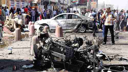 Car wreckage in Sadr City on Wednesday