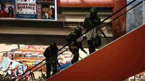 Soldiers move up stairs inside Westgate Mall in Nairobi Kenya on Saturday (CNN)