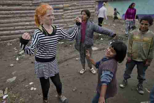 Sasha Ruseva, left, the Bulgarian mother of ten children, dancing on Friday (AP)