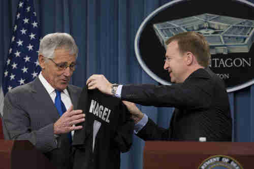 Defense Secretary Chuck Hagel receives a rugby jersey from New Zealand Defense Minister Jonathan Coleman on Monday