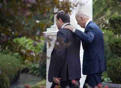 Vice President Joe Biden walks with Nuri al-Maliki on Wednesday (AP)
