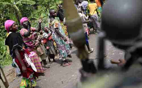 Residents cheer as Congolese soldiers pass through after defeating M23 rebels (AP)