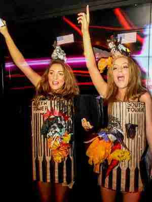 Girls wearing burning Twin Towers costumes