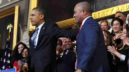Obama and Mass. governor Deval Patrick at Boston's Faneuil Hall on October 30 for speech selling Obamacare (Boston Herald)