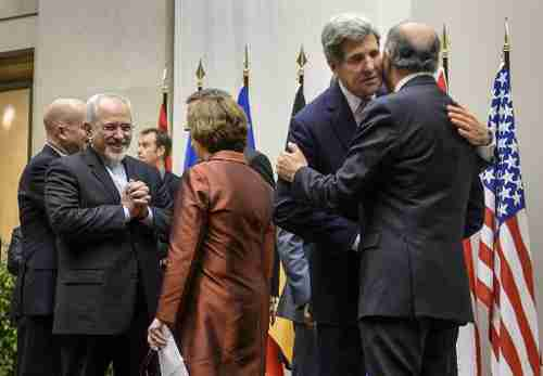 Foreign ministers from (L-R) Iran, EU, U.S. and France laugh and hug after reaching agreement in Geneva on Sunday (AFP)