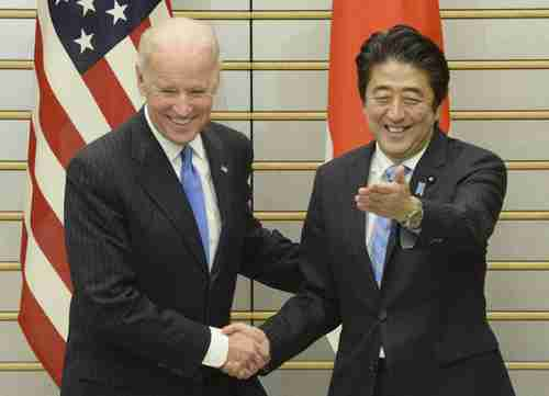 Joe Biden and Shinzo Abe, meeting Tuesday in Tokyo (AP)
