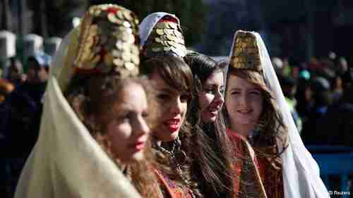 Girls dress in traditional clothes at Bethlehem Christmas Eve celebrations (Deutsche-Welle)