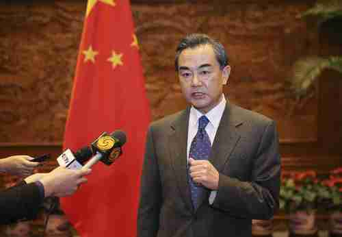 China's foreign minister Wang Yi bares his teeth in a scathing TV interview criticizing Abe's visit to Yasukuni Shrine (Xinhua)
