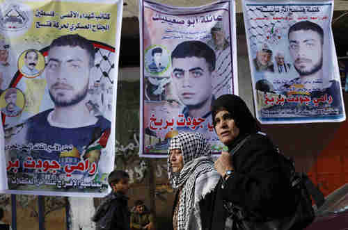 Palestinian families in the occupied West Bank and Gaza make preparations to receive the released prisoners (Reuters)