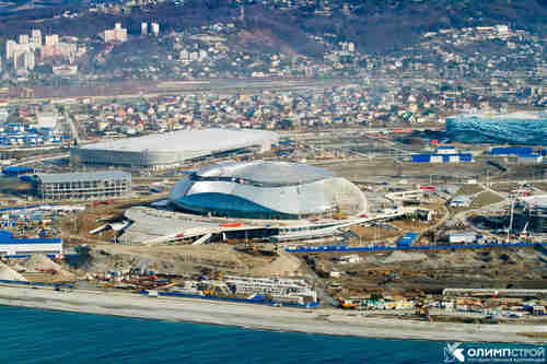 Sochi by the beach, with snowy mountains in the distance