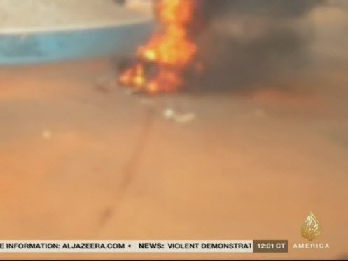Body burning, after being hacked to pieces on Sunday morning (Al-Jazeera)#