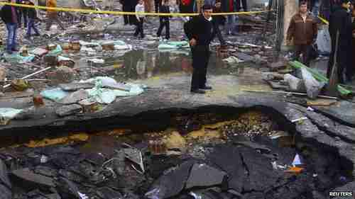 Huge crater in front of Cairo police station from Friday's terrorist bombing (Reuters)