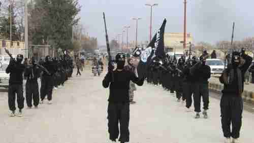 ISIS fighter parade in Syrian town on January 2 (Reuters)