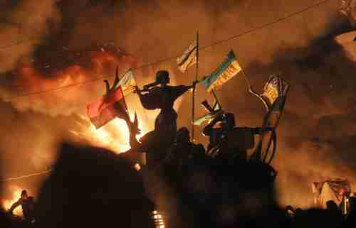 Monuments to Kiev's founders burn on Tuesday (AP)