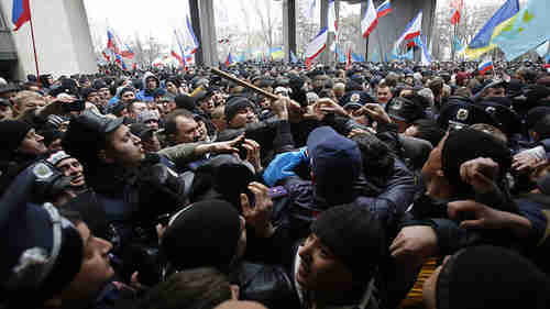 Pro-Russian protesters (left) clash with Crimean Tatars (right) on Wednesday (AP)