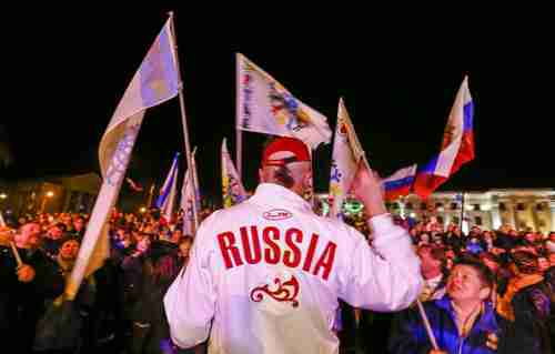 Russia supporters celebrate in Simferopol, Crimea, on Friday (Reuters)