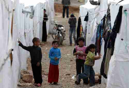Syrian children play at a refugee camp in Arsal on Friday.  A suicide car bomb exploded on Saturday.  (AFP)