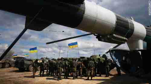 Ukrainian troops receive munitions at a field in east Ukraine on Tuesday (CNN)