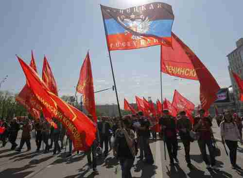 At Mayday rally, banners include the flag of the self-declared 'People's Republic of Donetsk [Ukraine]' (Reuters)
