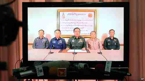 General Prayuth Chan-ocha (center) announces his army coup on nationwide television on Thursday