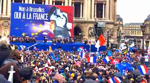 Marine Le Pen rally in Paris. The sign says, 'No to Brussels, yes to France.'