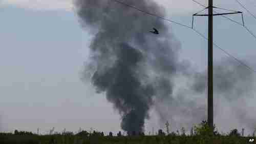 Black smoke rising from the scene of the helicopter crash (AP)