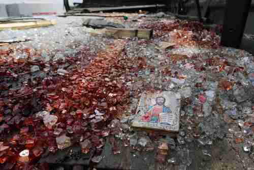 A blood-stained icon of Jesus lies in blood-soaked shattered glass after a clash on Tuesday at Donetsk airport (Reuters)