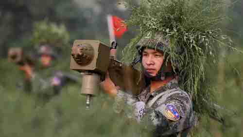 Chinese soldier in live-fire air defense exercise in 2010 (AP)