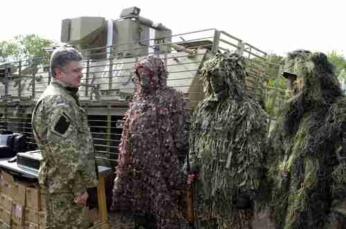 Petro Poroshenko visits the Ukrainian troops last week (AP)