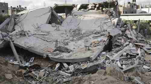 Palestinians inspect the site of an Israeli air strike on Gaza (BBC)