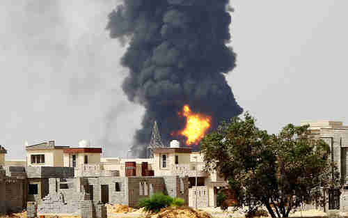 Black smoke rises about Tripoli fuel depot fire (AFP)
