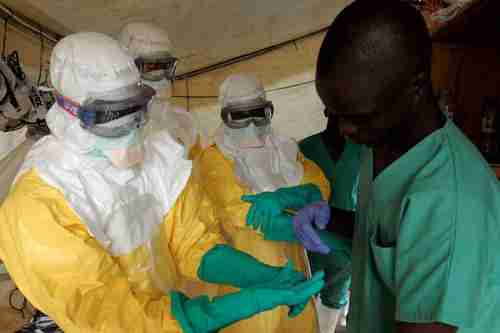 Health workers wearing suits to protect themselves from Ebola (EPA)