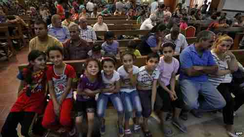 Iraqi Christians who fled the city of Qaraqosh and are now sitting in Saint Joseph Church in Erbil (BBC)