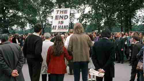 A man with a sign saying THE END IS AT HAND talks to the crowd at Speakers' Corner, Hyde Park, London on 11 June 1972 (BBC)