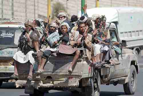 Houthi fighters in back of pickup truck on Sunday in Sanaa (AFP)
