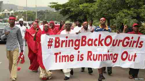 Nigerians carrying 'Bring back our girls' banner (Reuters)