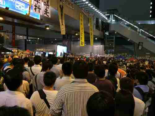 Hong Kong students watch televised debate on Tuesday evening (Finance Asia)