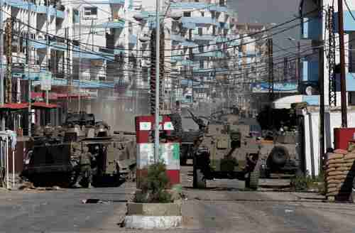 Lebanon's army tanks arrive in neighborhoods of Tripoli in northern Lebanon (AP)